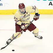 Bill Arnold #24 of the Boston College Eagles with the puck during The Beanpot Championship Game at TD Garden on February 10, 2014 in Boston, Massachusetts. (Photo by Elan Kawesch)