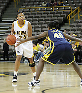 08 February 2007: Iowa forward Jenee Graham (24) is guarded by Michigan guard Janelle Cooper (40) in Iowa's 66-49 win over Michigan at Carver-Hawkeye Arena in Iowa City, Iowa on February 8, 2007.
