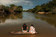 Amerindian doing laundry in the Rupununi River<br /> Karanambu Lodge<br /> Rupununi<br /> GUYANA<br /> South America
