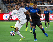 LAFC midfielder Mark-Anthony Kaye (14) defends against San Jose Earthquakes forward Danny Hoesen (9) during an MLS soccer match. LAFC defeated the San Jose Earthquakes 4-0 on Wednesday, Aug. 21, 2019, in Los Angeles. (Ed Ruvalcaba/Image of Sport)