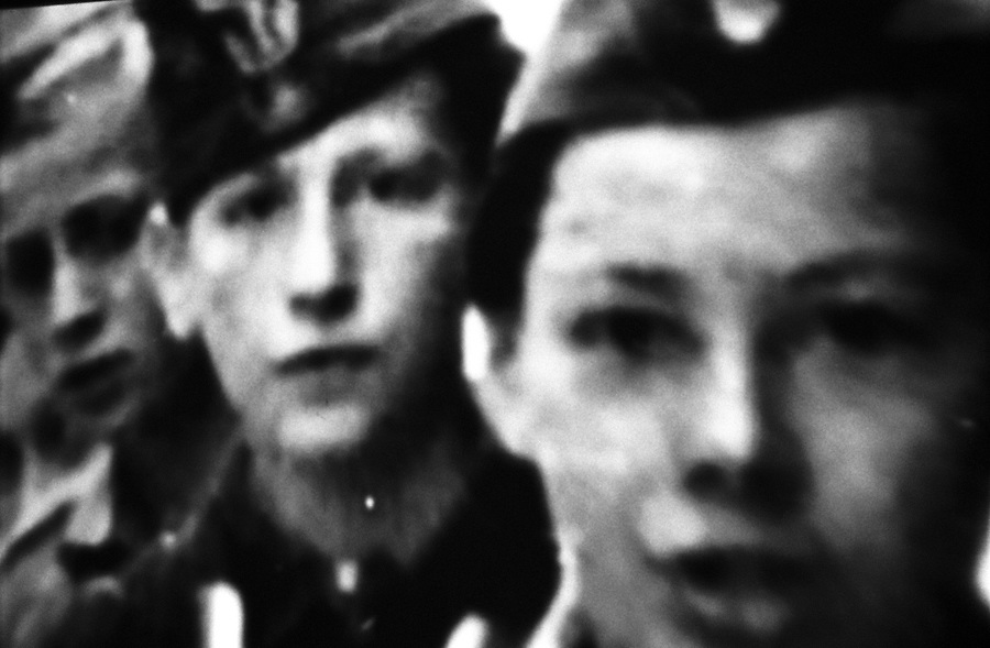 Warsaw Uprising Museum, detail of a vintage video showing boy-scouts. The boy-scouts were very active as messengers during 1944 Warsaw Uprising. A parallel, clandestine postal network was organized by these young scouts and was largely used by the Warsaw population during the Nazi occupation.