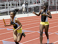 Meadowdale's Ashley Bumpus (left) takes the handoff from Nakeisha Jones and begins the final lap of the Girls 4x400 Meter Relay during the Buff Taylor Memorial Track & Field Invitational at the Good Samaritan Sports Plex at Trotwood Madison High School, Saturday, May 10, 2008.