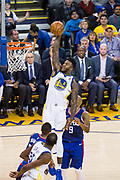 Golden State Warriors forward Jordan Bell (2) dunks the ball against the LA Clippers at Oracle Arena in Oakland, Calif., on January 10, 2018. (Stan Olszewski/Special to S.F. Examiner)
