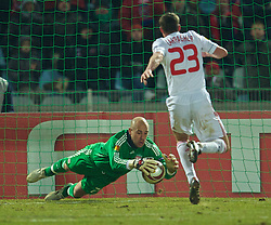 LILLE, FRANCE - Thursday, March 11, 2010: Liverpool's goalkeeper Pepe Reina makes a save after fumbling the ball during the UEFA Europa League Round of 16 1st Leg match against LOSC Lille Metropole at the Stadium Lille-Metropole. (Photo by David Rawcliffe/Propaganda)