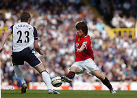 Photo: Leigh Quinnell.<br /> Tottenham Hotspur v Manchester United. The Barclays Premiership. 17/04/2006. Man Utds' Park Ji-Sung takes the ball round Tottenhams Michael Carrick.