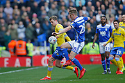 Leeds United forward Patrick Bamford (9)  and Birmingham City defender Michael Morrison  contest a loose ball  during the EFL Sky Bet Championship match between Birmingham City and Leeds United at St Andrews, Birmingham, England on 6 April 2019.