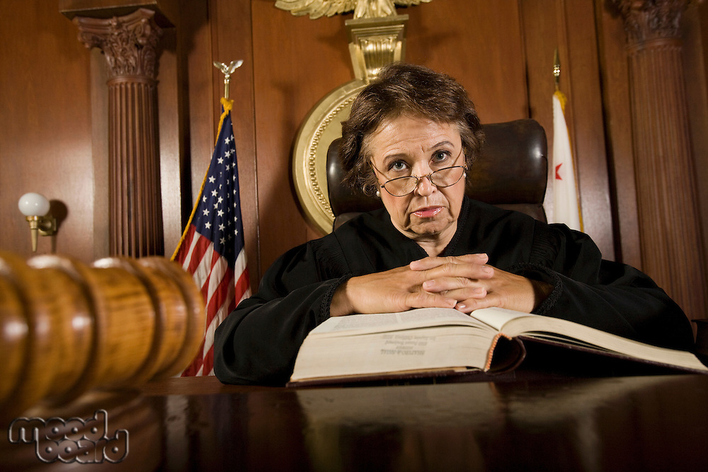 Judge sitting in court, portrait