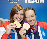 Joanna Rowsell and Dani King of the Women's Team Pursuit at Team GB House, Stratford, London, Great Britain after winning an Olympic  Gold Medal in the Velodrome. (Laura Trott also in the team was missing from the photo).<br />