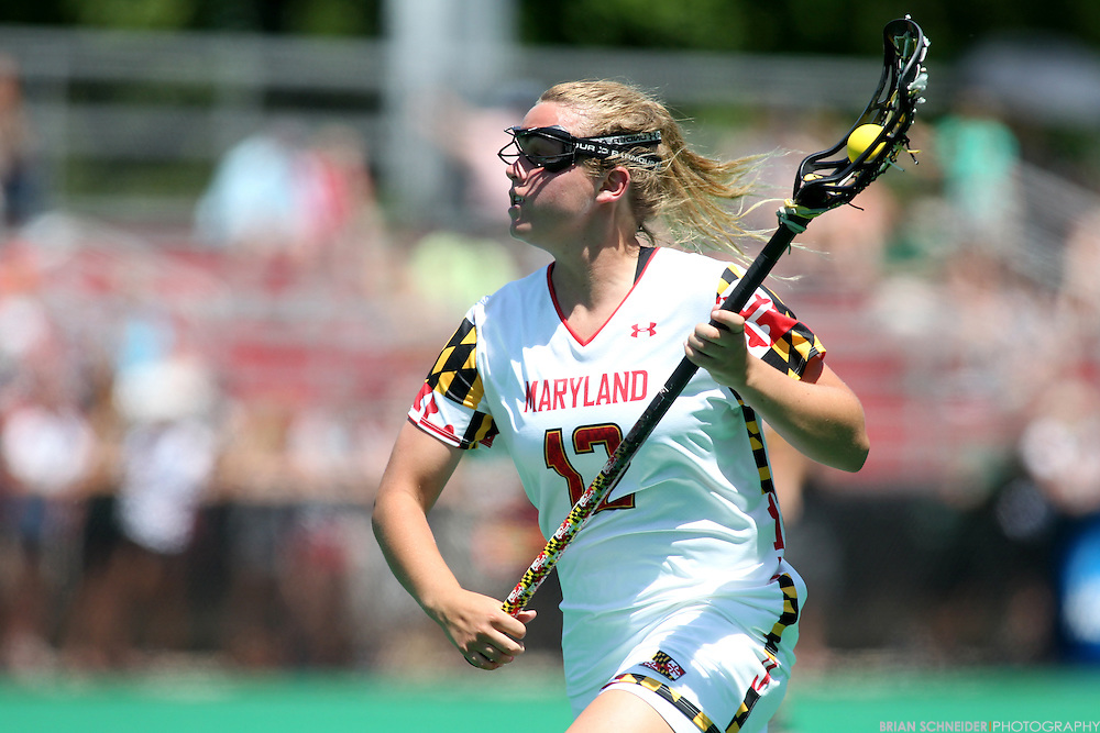 May 19, 2012; College Park, MD, USA; Maryland Terrapins midfielder Erin Collins (12) controls the ball against the Loyola Greyhounds in the second round NCAA Women's Lacrosse Tournament. Mandatory Credit: Brian Schneider-www.ebrianschneider.com