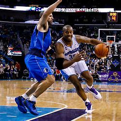 November 17, 2010; New Orleans, LA, USA; New Orleans Hornets power forward David West (30) drives past Dallas Mavericks point guard Jason Kidd (2) during a game at the New Orleans Arena. The Hornets defeated the Mavericks 99-97. Mandatory Credit: Derick E. Hingle