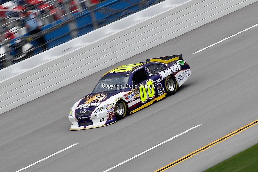 April 15, 2011; Talladega, AL, USA; NASCAR Sprint Cup Series driver David Reutimann (00) during practice for the Aarons 499 at Talladega Superspeedway.   Mandatory Credit: Derick E. Hingle