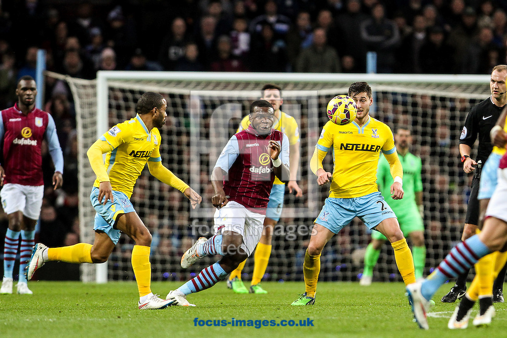 Damien Delaney of Crystal Palace (right) competing with Christian Benteke of Aston Villa (centre) during the Barclays Premier League match at Villa Park, Birmingham<br /> Picture by Andy Kearns/Focus Images Ltd 0781 864 4264<br /> 01/01/2015