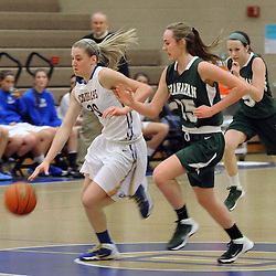 Staff photos by Tom Kelly IV<br /> East's Paige Warfel (20) dribbles down court with Shanahan's Grace Phillips (25) in pursuit, during the Bishop Shanahan at Downingtown East girls basketball game, Thursday night December 18, 2013.