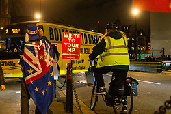 """Pro-Remain and People's Vote campaigner Steve Bray welcomes a bus emblazoned with """"Bollocks to Brexit: to Old Palace Yard outside Parliament.. Westminster, London, December 20 2018."""