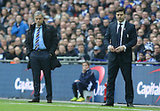 Chelsea Manager Jose Mourinho and Tottenham Hotspur Manager Mauricio Pochettino during the Capital One Cup Final between Chelsea and Tottenham Hotspur at Wembley Stadium, London, England on 1 March 2015. Photo by Phil Duncan.