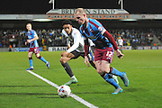 Neil Bishop of Scunthorpe United and Sean Clare (43)  during the Sky Bet League 1 match between Scunthorpe United and Bury at Glanford Park, Scunthorpe, England on 19 April 2016. Photo by Ian Lyall.