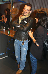 Fashion designer MATTHEW WILLIAMSON at a Topshop hosted Jumbo Thrift Sale - a sale of designer fashion, in association with the Terence Higgins Trust for World Aids Day, held at Topshop, Oxford Circus, London on 1st December 2004.<br />