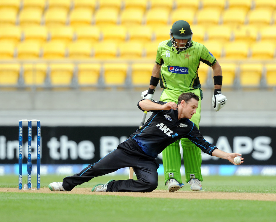 New Zealand's Nathan McCullum fields in front of Pakistan's Misbah-ul-Haq in the 1st One Day International cricket match at Westpac Stadium, New Zealand, Saturday, January 31, 2015. Credit:SNPA / Ross Setford