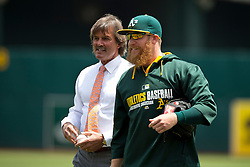 OAKLAND, CA - JUNE 21:  Former Oakland Athletics player Dennis Eckersley stands next to Sean Doolittle #62 after throwing out the ceremonial first pitch before the game against the Boston Red Sox at O.co Coliseum on June 21, 2014 in Oakland, California. The Oakland Athletics defeated the Boston Red Sox 2-1 in 10 innings.  (Photo by Jason O. Watson/Getty Images) *** Local Caption *** Dennis Eckersley; Sean Doolittle