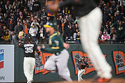 San Francisco Giants first baseman Chris Marrero (49) catches a Oakland Athletics fly ball at AT&T Park in San Francisco, California, on March 30, 2017. (Stan Olszewski/Special to S.F. Examiner)