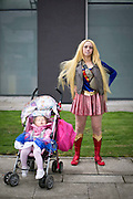 UNITED KINGDOM, London: 24 October 2014. <br /> Comic Con Feature.<br /> Cosplay fan Katie Young (right) poses for a picture with her daughter Rachel Young as they make their way to the London Comic Convention 2014.<br /> Photo: Rick Findler / Story Picture Agency