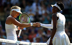 Kiki Bertens shakes hands with Venus Williams after her win on day five of the Wimbledon Championships at the All England Lawn Tennis and Croquet Club, Wimbledon.