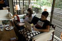 Young Jakartanese relax at Casa, a trendy cafe in Kemang Raya.