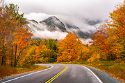 Driving through Franconia Notch while scouting for a workshop, I witnessed this awesome scene in front of me. Some of the few craggy peaks in New England were shrouded in fast moving fog and mist, and each second the composition changed as the dark masses of mountains disappeared and returned from behind these vapors. The past peak foliage framed the road and I knew in my heart that this image would tell an awesome story.