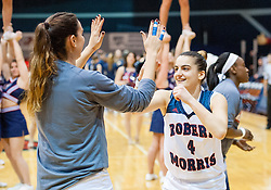 March 6 2016: Robert Morris Colonials guard Anna Niki Stamolamprou (4) jokes around with Robert Morris Colonials guard Rebeca Navarro (10) before the start of the NCAA Women's Basketball game between the Fairleigh Dickinson Lady Knights and the Robert Morris Colonials at the Charles L. Sewall Center in Moon Township, Pennsylvania (Photo by Justin Berl)