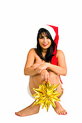 Young sexy Asian woman wearing Santa hat