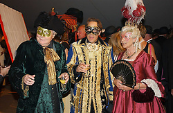 Left to right, the DUKE OF RICHMOND & GORDON, his son the EARL OF MARCH & KINRARA and the DUCHESS OF RICHMOND & GORDON at the 2004 Goodwood Revival ball this year theme was a Venetian Masked Ball, held at Goodwood Motor Racing circuit, West Sussex on 4t September 2004.