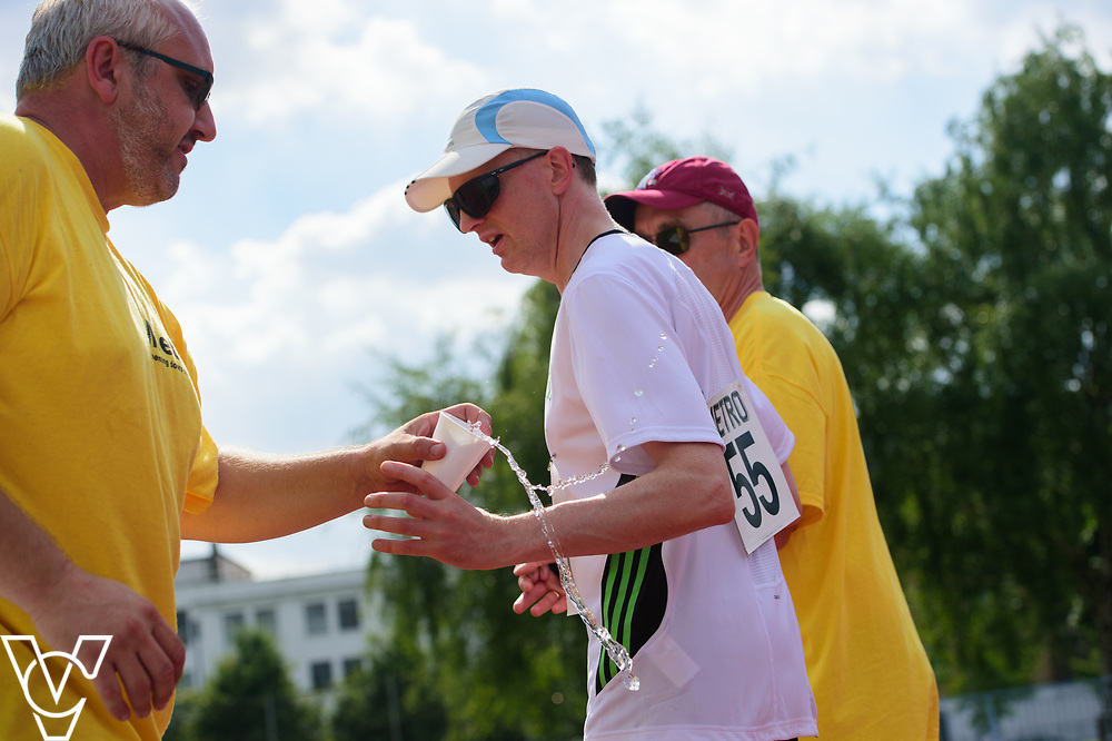 Metro Blind Sport's 2017 Athletics Open held at Mile End Stadium.  5000m.  Competitor #55 with guide and volunteer<br /> <br /> Picture: Chris Vaughan Photography for Metro Blind Sport<br /> Date: June 17, 2017