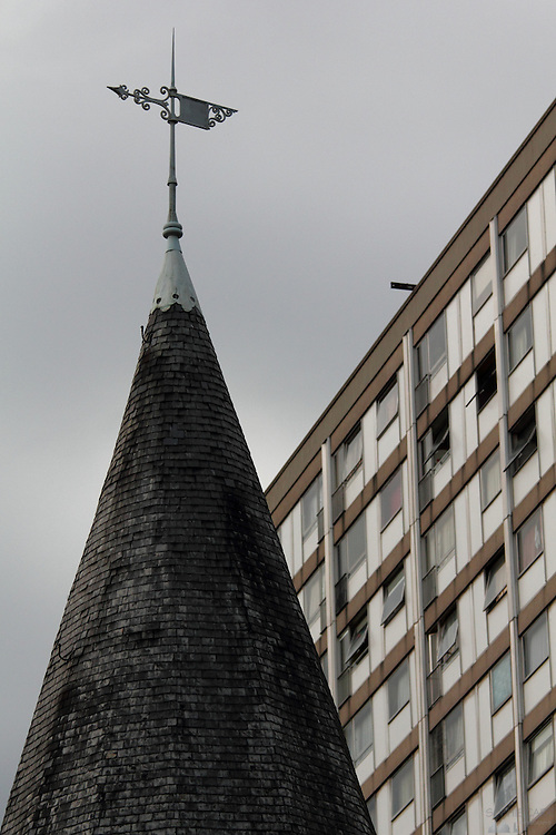 An ugly tower blocks seen behind a traditional spire in north-east Ghent; the tower blocks will be pulled down in 2012, apparently