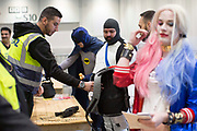 UNITED KINGDOM, London: 27 October 2017 Cosplay fans have their bags and 'weapons' inspected at the entrance to the MCM London Comic Con. The convention, which runs all this weekend at the Excel Centre, will see thousands of cosplay and comic book fans visit the venue. Rick Findler / Story Picture Agency