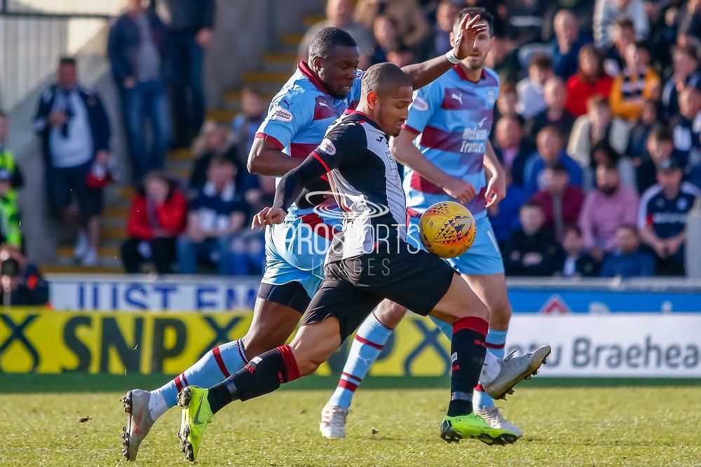 Simeon Jackson of St Mirren wins the ball during the Ladbrokes Scottish Premiership match between St Mirren and Dundee at the Paisley 2021 Stadium, St Mirren, Scotland on 30 March 2019.