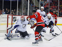 March 7, 2008; Newark, NJ, USA; Tampa Bay Lightning goalie Karri Ramo (31) makes a save on a shot by New Jersey Devils right wing David Clarkson (23) during the second period at the Prudential Center in Newark, NJ.