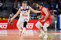 Real Madrid's Luka Doncic and Crvena Zvezda Mts Belgrade's Branko Lazio during Turkish Airlines Euroleague match between Real Madrid and Crvena Zvezda Mts Belgrade at Wizink Center in Madrid, Spain. March 10, 2017. (ALTERPHOTOS/BorjaB.Hojas)