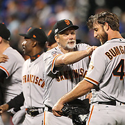 NEW YORK, NEW YORK - October 5: Pitcher Madison Bumgarner #40 of the San Francisco Giants is congratulated by team mates after his nine inning shut out during the San Francisco Giants Vs New York Mets National League Wild Card game at Citi Field on October 5, 2016 in New York City. (Photo by Tim Clayton/Corbis via Getty Images)