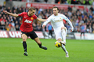 Swansea city's Michu ® goes past Nemanja Vidic of Man Utd. Barclays premier league, Swansea city v Manchester Utd at the Liberty stadium in Swansea, South Wales on Sunday 23rd Dec 2012. pic by Andrew Orchard, Andrew Orchard sports photography,