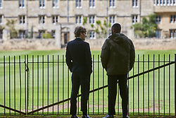 © Licensed to London News Pictures. 19/05/2015. OXFORD, UK. Filming of ITV drama Endeavour, telling the story of the early life of Inspector Morse, taking place in Christ Church Meadow in Oxford. <br /> <br /> In this picture: Shaun Evans (left)(who plays Endeavour Morse) with actor Charles Babalola<br /> <br /> Photo credit : Cliff Hide/LNP
