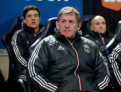 BOLTON, ENGLAND - Saturday, January 21, 2011: Liverpool's manager Kenny Dalglish on the bench before the Premiership match against Bolton Wanderers at the Reebok Stadium. (Pic by David Rawcliffe/Propaganda)