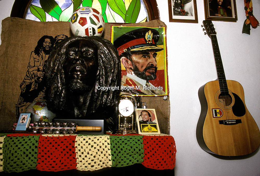 Inside the burial crypt of Reggae superstar Bob Marley, some of his personal possessions around him, July 1991, in the valley of Nine Miles in St. Ann, Jamaica. In the picture is a bust of Marley; a photograph of him; a soccer ball, Marley's favorite sport; a poster of the late Haile Selassie, emperor of Ethiopia, revered as a living god by Rastafarians; and Marley's guitar. Bob Marley died of cancer in a Miami hospital at the age of 36 on May 11, 1981. (Photo by Roger M. Richards)