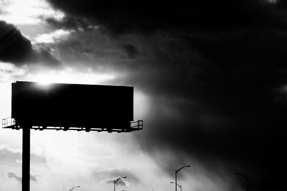 Angry sky and billboard silhouette on NJ Turnpike. 2009