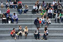 © Licensed to London News Pictures. 31/05/2013. London, UK Office workers rest on the stairs of City Hall. Children and office workers enjoy the hot weather near to City Hall and Tower Bridge in London today May 31st 2013. Photo credit : Stephen Simpson/LNP