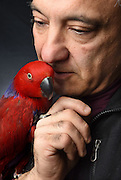 "Photo by Mara Lavitt -- Special to the Hartford Courant<br /> March 21, 2015, Middletown<br /> The eighth FeatherFest was held in Middletown by the Connecticut Parrot Society providing visitors with education about parrots and other birds. Peter Lombardo of Rocky Hill with his eclectus parrot named Ava. Lombardo says about Ava, ""She talks. She's a character. She laughs. We take her out in a cat carrier for presentations. She was at UConn last week for a college level presentation. They [parrots] are still wild, they're not domesticated."""
