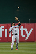 San Francisco Giants shortstop Brandon Crawford (35) catches a pop fly against the Oakland Athletics at Oakland Coliseum in Oakland, California, on July 31, 2017. (Stan Olszewski/Special to S.F. Examiner)
