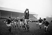 Up go, Dwyer, Ireland, and Brown, Scotland, in this line out, .Players include, left-right, McLoughlin, Irish captin Mulcahy, and Murphy, Ireland, JB Neill, Scottish captain and McBride, Ireland,..Irish Rugby Football Union, Ireland v Scotland, Five Nations, Landsdowne Road, Dublin, Ireland, Saturday 22nd February, 1964,.22.2.1964, 22.2.1964,..Referee- A C Luff, Rugby Football Union, ..Score- Ireland 3 - 6 Scotland, ..Irish Team, ..T J Kiernan,  Wearing number 15 Irish jersey, Full Back, Cork Constitution Rugby Football Club, Cork, Ireland,..P J Casey, Wearing number 14 Irish jersey, Right Wing, University College Dublin Rugby Football Club, Dublin, Ireland, ..M K Flynn, Wearing number 13 Irish jersey, Right Centre, Wanderers Rugby Football Club, Dublin, Ireland, ..J C Walsh,  Wearing number 12 Irish jersey, Left Centre, University college Cork Football Club, Cork, Ireland,..K J Houston, Wearing number 11 Irish jersey, Left Wing, Queens University Rugby Football Club, Belfast, Northern Ireland,..C M H Gibson, Wearing number 10 Irish jersey, Stand Off, Cambridge University Rugby Football Club, Cambridge, England, and, N.I.F.C, Rugby Football Club, Belfast, Northern Ireland, ..J C Kelly, Wearing number 9 Irish jersey, Scrum Half, University College Dublin Rugby Football Club, Dublin, Ireland,..P J Dwyer, Wearing number 1 Irish jersey, Forward, University College Dublin Rugby Football Club, Dublin, Ireland, ..A R Dawson, Wearing number 2 Irish jersey, Forward, Wanderers Rugby Football Club, Dublin, Ireland, ..R J McLoughlin, Wearing number 3 Irish jersey, Forward, Gosforth Rugby Football Club, Newcastle, England, ..W A Mulcahy, Wearing number 4 Irish jersey, Captain of the Irish team, Forward, Bective Rangers Rugby Football Club, Dublin, Ireland,  ..W J McBride, Wearing number 5 Irish jersey, Forward, Ballymena Rugby Football Club, Antrim, Northern Ireland,..E P McGuire, Wearing number 6 Irish jersey, Forward, University college Galway Football Club, Galway, Ireland,