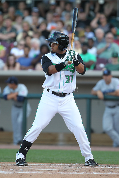 Dayton Dragons outfielder Juan Silva #27 bats during a game against the Lake County Captains at Fifth Third Field on June 25, 2012 in Dayton, Ohio. Lake County defeated Dayton 8-3. (Brace Hemmelgarn)