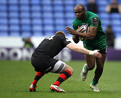London Irish's Topsy Ojo is tackled by Edinburgh's Anton Bresler - Photo mandatory by-line: Robbie Stephenson/JMP - Mobile: 07966 386802 - 05/04/2015 - SPORT - Rugby - Reading - Madejski Stadium - London Irish v Edinburgh Rugby - European Rugby Challenge Cup