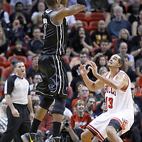 29 January 2012: Miami Heat power forward Chris Bosh (1) takes a jumpshot over Chicago Bulls center Joakim Noah (13) during the Miami Heat 97-93 victory over the Chicago Bulls at the AmericanAirlines Arena, Miami, Florida, USA.